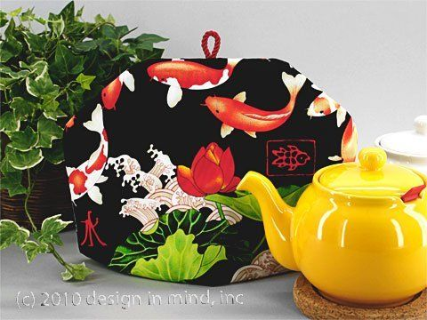 Tea Cozy - Midnight Koi|Standard . $29.95. Multi-colored koi splash across this tea cozy accented with bright green plants on a black quilters cotton.