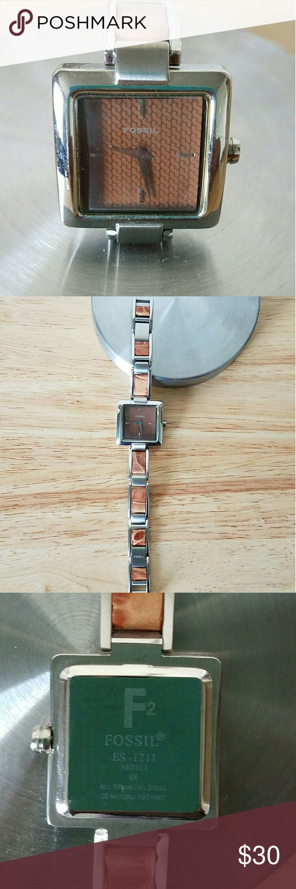 Vintage Fossil Watch Vintage Silver and Tan link women's watch. Perfect physical condition with no flaws however needs a watch battery. Fossil Jewelry