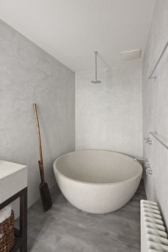 This would be the bath and shower head layout at the end of the shower hall. The tub would be stone carved with earthy patterns. The floor would have black river pebbles, and a moss 'bath mat'. The walls would have small foggy windows throughout incorporated into aquatic mosaic.