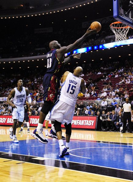 d55f4539bc6779 Shaquille O Neal Vince Carter Photos - Shaquille O Neal  33 of the  Cleveland Cavaliers goes to the basket over Vince Carter  15 of the Orlando  Magic during ...