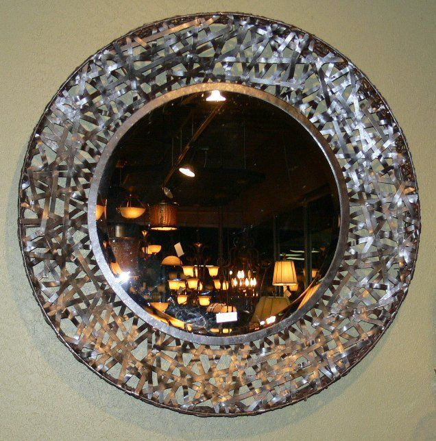 Our Black Messed Metal Contemporary Wall Mirror adds spice to any bathroom.