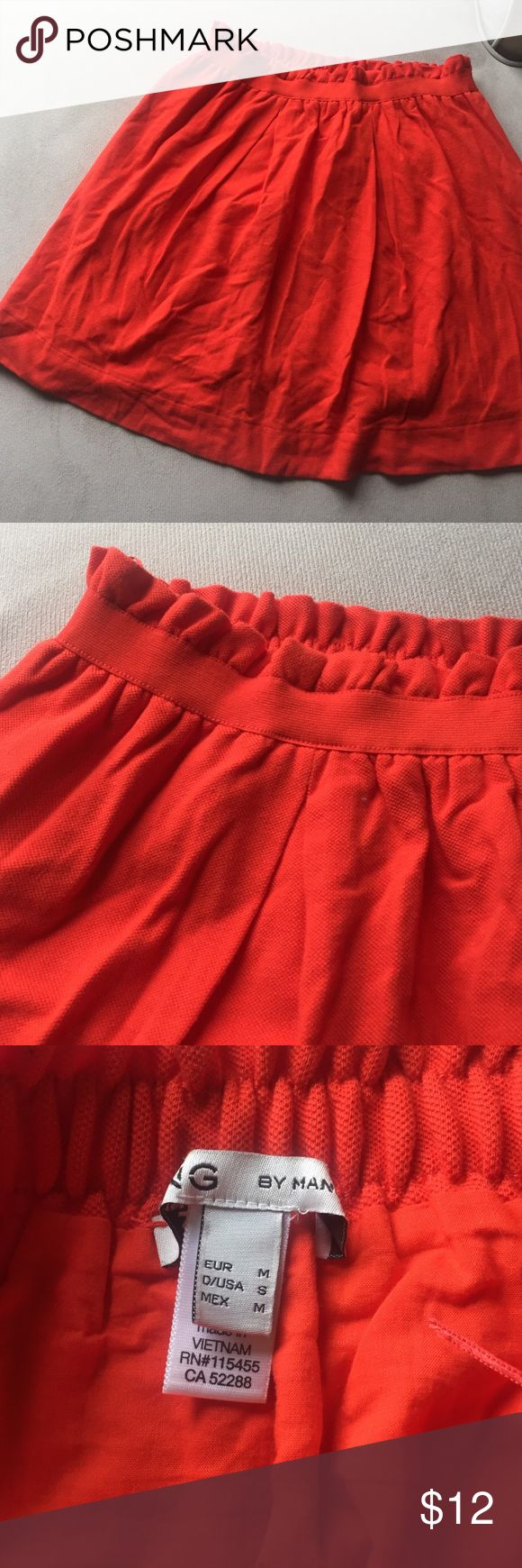 Orange cotton mini skirt The orange of the skirt is not as bright as shown in the picture for some reason I can't seem to get true color of the skirt in picture. It's a little more dulled and less blood orange. The tag says it's a size small but I think it runs big and fits more medium/large. It has elastic waistband so it stretches and can fit larger. 100% cotton so very soft. Mango Skirts Mini