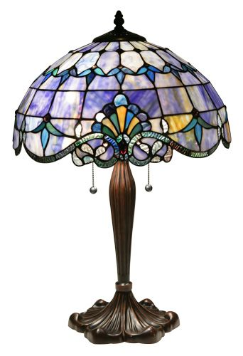 This blue Tiffany table lamp features a classic design and nuetral shade profile making it a perfect fit for any room.