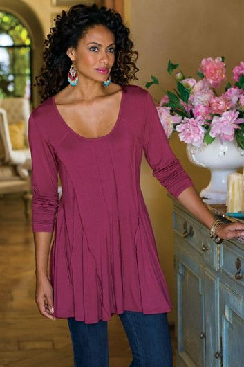 Our Slimming Seams Tunic is a curve-caressing jersey knit tunic which enhances figures of all types as it flows over the body.