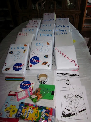 astronaut backpacks--cereal boxes covered in white craft paper, attached with straps and decorated by party guests http://www.dawnwhispersandshouts.blogspot.com/2012/05/since-boys-are-in-love-with-all-things.html