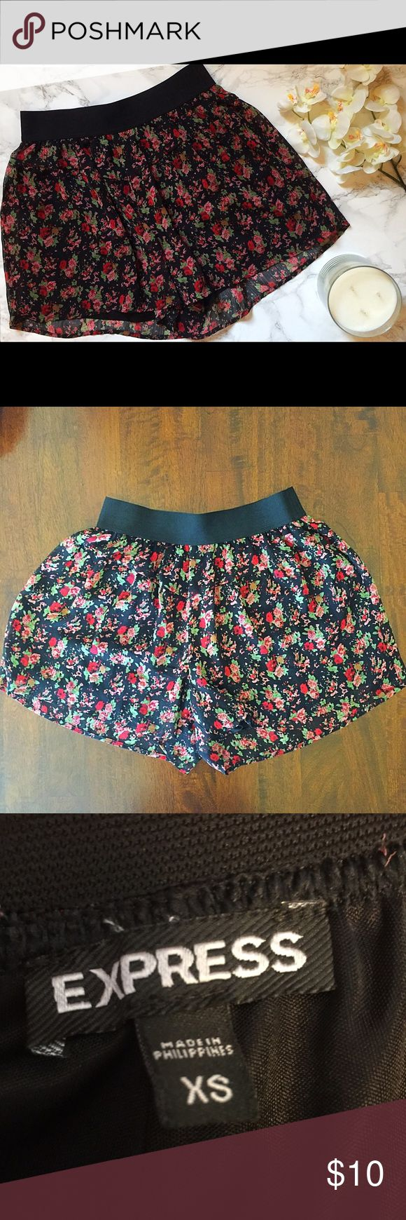 Floral print shorts These flowy, floral print shirts may look like a skirt, but they aren't, I promise! (Ladies, think trying to bend ice in a skirt-then you'll know why these shorts are amazing!) These have a black lining inside, with a sheer black, red, pink, and green sheer overlay. Also has a black elastic waistband. In wonderful condition! Express Shorts