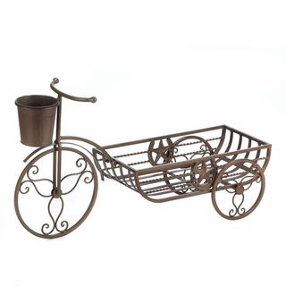 $49.95 - Let your favorite potted plant ride through the day in this charming cast iron Western-themed bicycle.