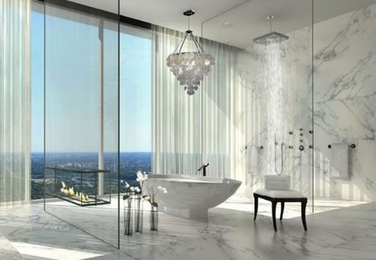 Marble bath.  With of course floating glass fireplace.  Wow.