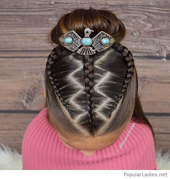 Awesome braids and bun with a nice accessory