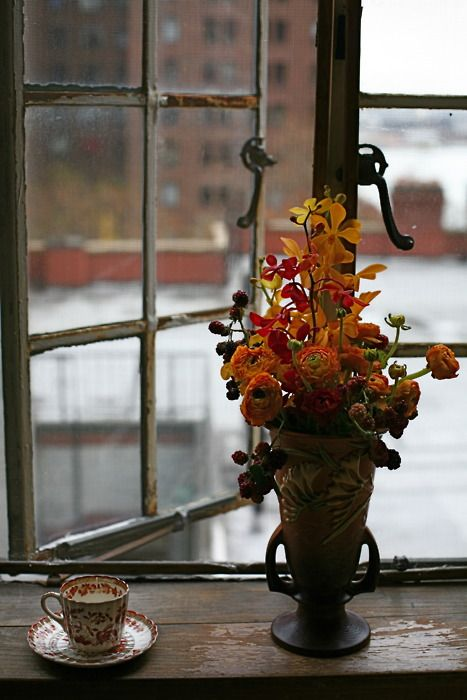 Oh my goodness... the feel of this place! So magnificent. The teacup, the old wood and window, the perfect amount of color with just a little bunch of flowers in an old vase. You can't make this kind of place. It just happens, I think, when you've been living in an old house long enough.