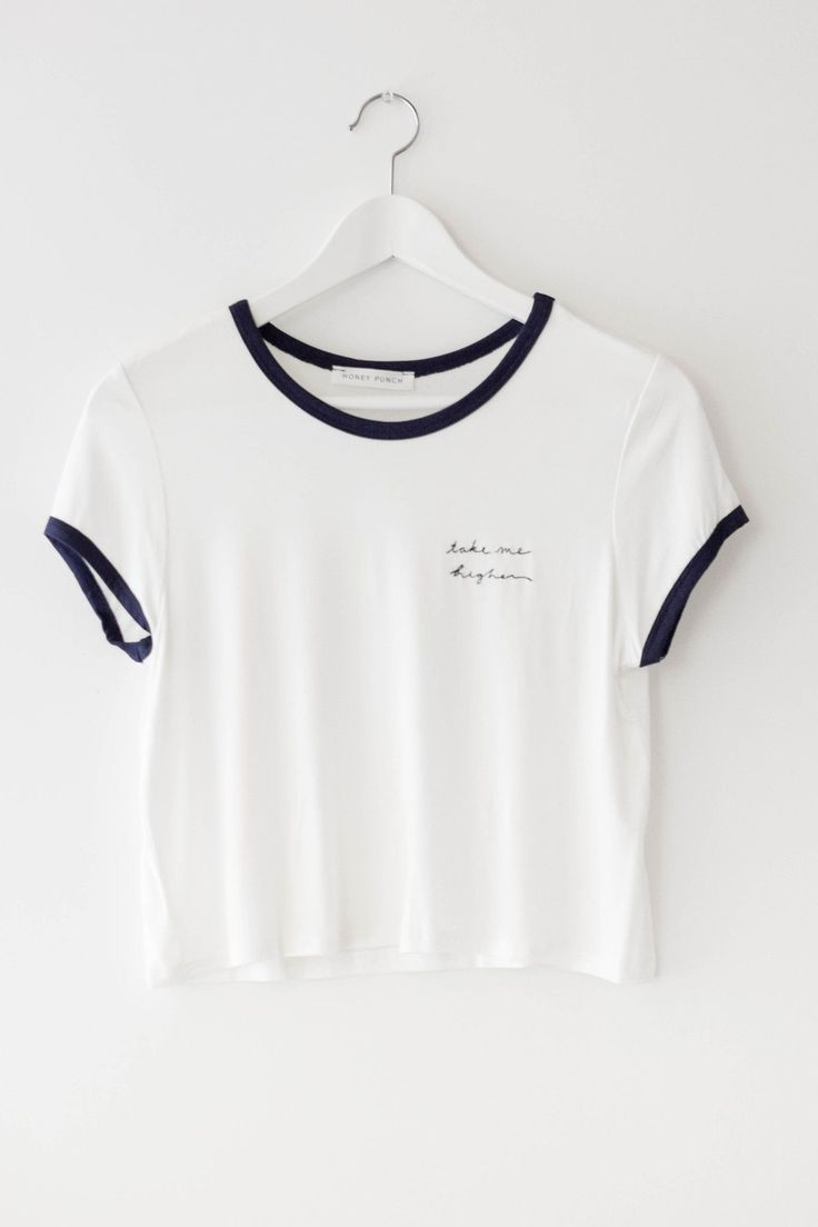 "Basic white crop top with embroidered text detailing and contrast navy blue color. Made with lightweight and stretchy jersey knit material. Size small measures approx. 18"" in length. - 97% Rayon 3% Sp"