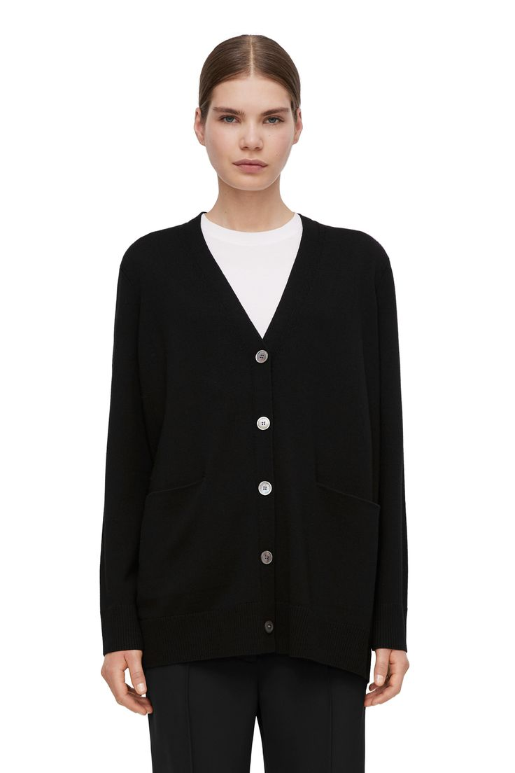 """<p style=""""text-align: justify;"""">Fully-fashion knitted in organic merino, this cardigan has a relaxed fit with a dropped shoulder. The front features a deep"""
