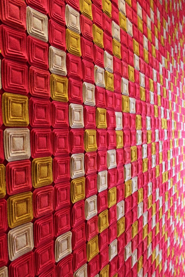 Wall covering in burel by Burel Penhas Douradas Factory. Various colors on Rasas stitches.