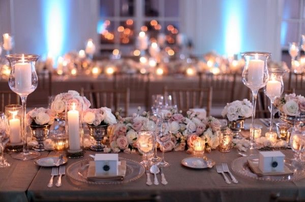 Insanely stunning and romantic tablescape that can melt any heart! Low-rise white, cream, and blush rose arrangements, dimly lit candles, vintage vases, and gold beaded chargers - PERFECTION!