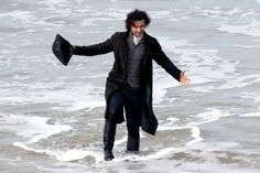 Poldark hunk Aiden Turner spotted filming on beach for new series