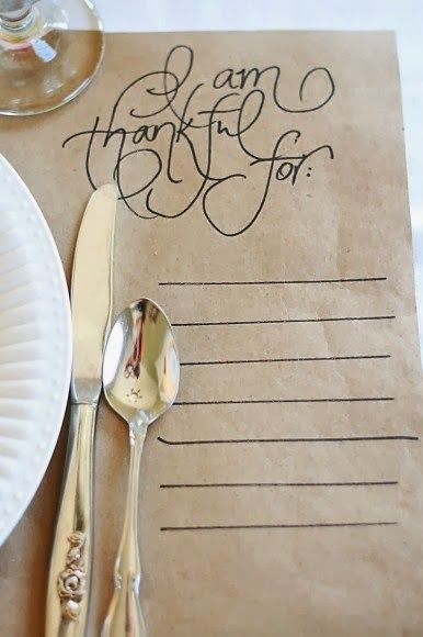 """So simple and genius!  Brown craft paper placemats with pretty script-- """"I am thankful for"""""""
