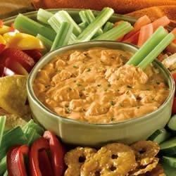 This robust and creamy appetizer features cream cheese, blue cheese salad dressing, cayenne pepper sauce, crumbled blue cheese and Swanson(R) Premium Chunk Chicken, heated together to make a dip that tastes like Buffalo chicken wings but without the mess!