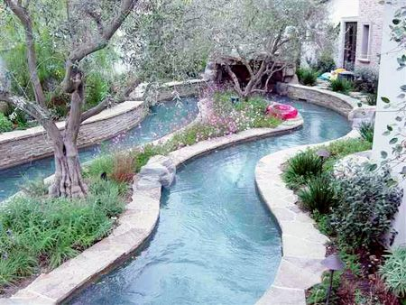Lazy river in the back yard! Yes please!  Imagine spending the summer floating down your own backyard river!