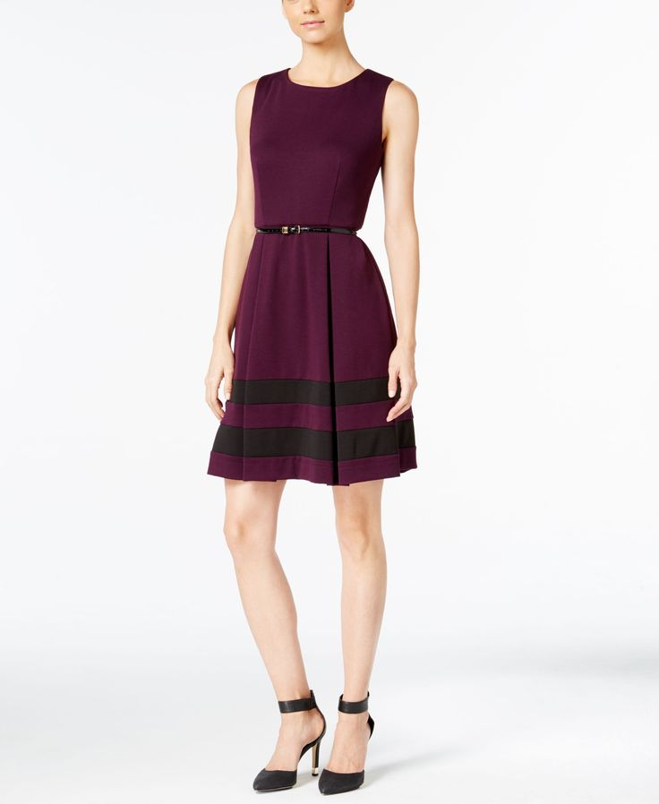 Effortlessly enviable style is yours in this timeless dress from Calvin Klein.   Polyester/rayon/spandex   Dry clean   Imported   Scoop neckline   Hidden back zipper with hook-and-eye closure   Sleeve
