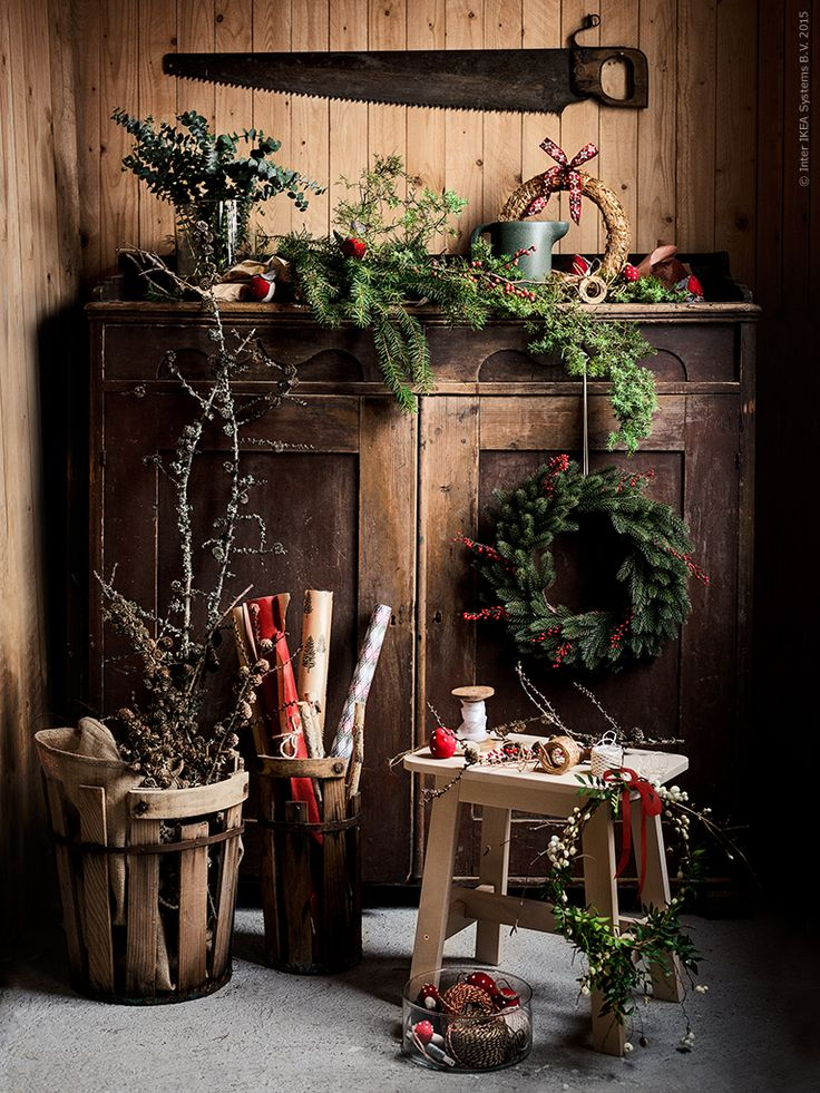 rustic cabinet & baskets, stool, wreath, wrapping paper, & saw