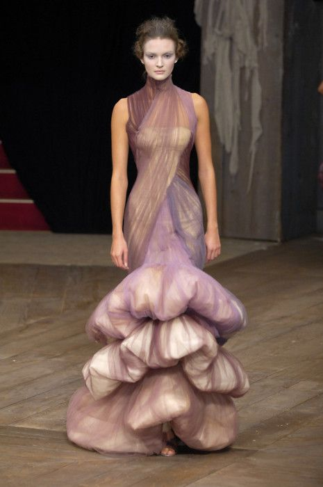 I normally love Alexander McQueen. but this Purple tulle over white looks a little like a woman working into surgery to ask for her excess growths to be removed