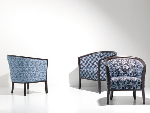 1402  Classic curved tub style armchair channels art deco form.  Wide range of finish and fabric.