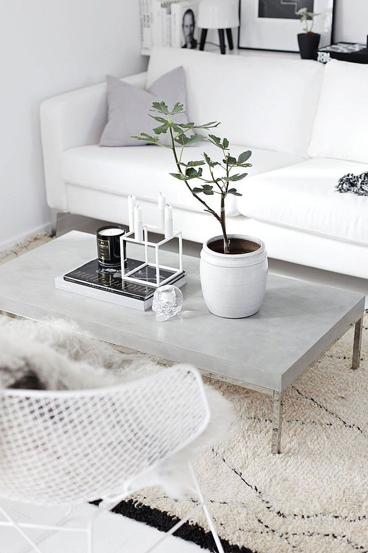 Black And White Scandinavian Living Room With A Concrete Coffee Table