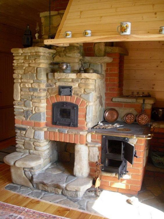 Large brick oven with a stone finish - featuring bread oven, cooker and fireplace by Janusz Wrzecionko, Poland. piecekamienne.pl