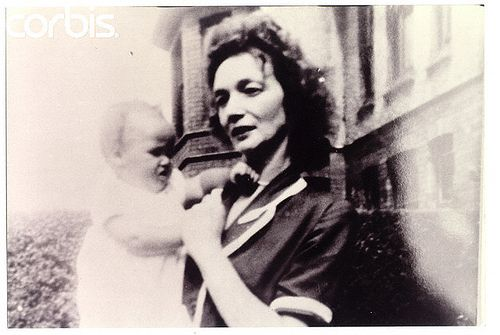 """Baby John Lennon and his mother -- """"Julia"""". She left him in the care of his Aunt Mimi, who may have been older, and more able to care for John. John wrote songs about """"Julia"""", did PRIMAL SCREAM, named his first son after her: Julian. It was the """"Depression"""" & actually typical for a child to have parents but find themselves partially orphaned."""
