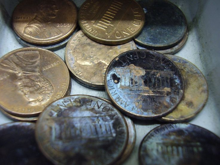 A bunch of old corroded coins - pennies. photo by Lottery Monkey on Flickr