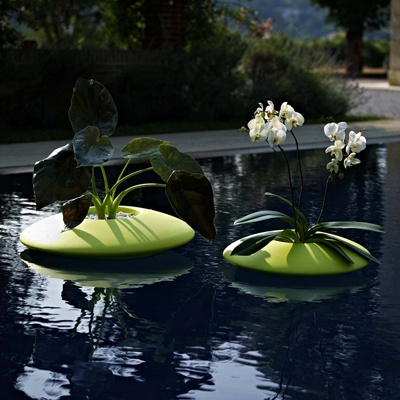 24 best floating on water planters images on pinterest for Plastic floating pond plants