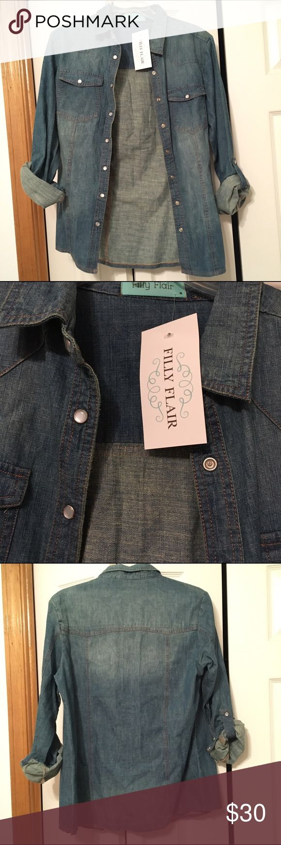 NWT filly flair button down denim top NWT filly flair button down denim top. Still has tags, never worn. Very nice sturdy material. 100% cotton. Size medium. Sleeves can be rolled up & snapped for a 3/4 length sleeve look. Great for layering. Would be cute with leggings (check out the ones in my closet!). 🛍bundle to save🛍 Filly Flair Tops Button Down Shirts