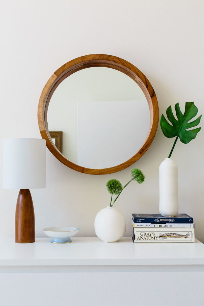 "There's some major <a href=""http://www.cb2.com/acacia-wood-24-wall-mirror/s379140?a=501&campaignid=372513035&adgroupid=26063241755&targetid=pla-63000991512&pla_sku=379140&scid=scplp16310461&a=501&campaignid=372513035&adgroupid=26063241755&targetid=pla-63000991512&adpos=1o1&creative=100419793235&device=c&matchtype=&network=g&gclid=CNTW8sHDss4CFQ9bhgod8rIDxw"" target=""_blank"">round mirror</a> love going on in this home!"
