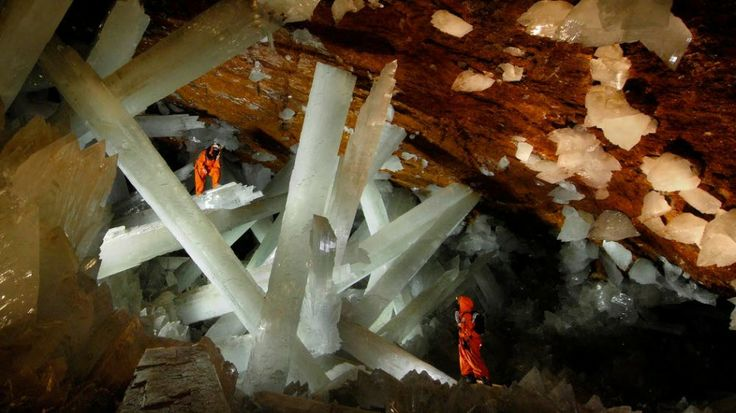 Cave of the Crystals, Mexico. Cave of the Crystals is a cave connected to the Naica Mine 300 metres below the surface in Naica, Chihuahua, Mexico. The main chamber contains giant selenite crystals (gypsum, CaSO4•2 H2O), some of the largest natural crystals ever found. The cave's largest crystal found to date is 12 m in length, 4 m in diameter and 55 tons in weight. The cave is extremely hot with air temperatures reaching up to 58 °C with 90 to 99 percent humidity.