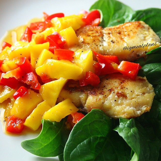 """""""Tonight's Dinner: Grilled Haddock on a bed of fresh Spinach topped with Mango Salsa Haddock: Season cleaned Haddock with salt, black pepper and lemon for…"""""""