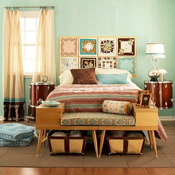 I love the idea of a soft, vintage inspired room with punches of fun colors and patterns. The headboard is made out of framed handkerchiefs! And those recycled drum end tables are killer!