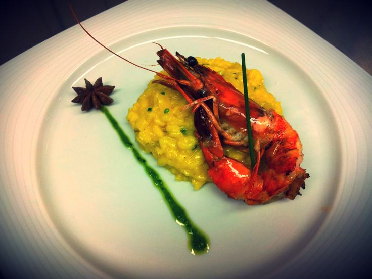Flavoured safran risoto with star anise  with grilled shrimp marinated in lime  parslεy pesto