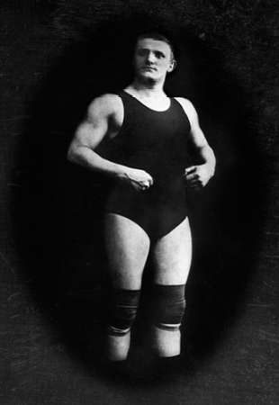 Bodybuilder in Wrestling Outfit and Knee Pads
