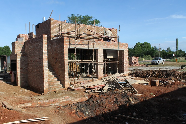 Building the flat on top of the pre-cast concrete rib and block decking system, above the garage.