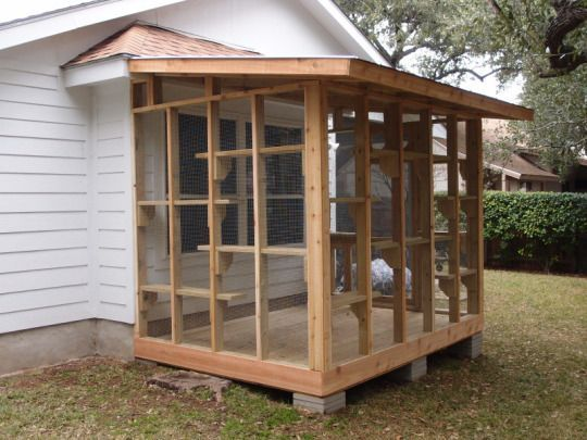 """<p>If you're up for a little bit more of an in-depth DIY project, consider building a """"catio"""" — an enclosed, cat-friendly patio that allows your indoor cat to experience the great outdoors without the danger… <i>(Photo: <a href=""""http://www.thecatcarpenter.com/Classic-catio.htm"""">The Cat Carpenter</a>)</i></p>"""