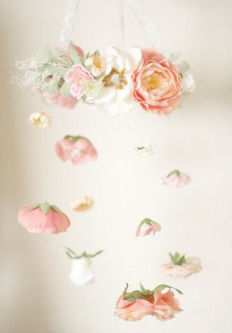 Combine flowers with pom poms to make a girlie mobile