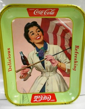 "This 1957 Coca-Cola tray is called the ""Umbrella Girl."" Although this one was printed in the U.S.A. it was never distributed there and is considered a ""Canadian"" tray. A French version was made for use in Quebec, Canada."