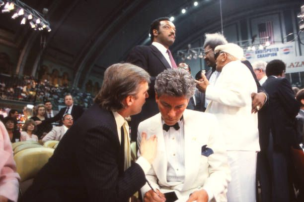 Businessman Donald Trump and Ring Announcer Michael Buffer with Reverend Jesse Jackson Actor Redd Foxx and Promoter Don King in background at Tyson...