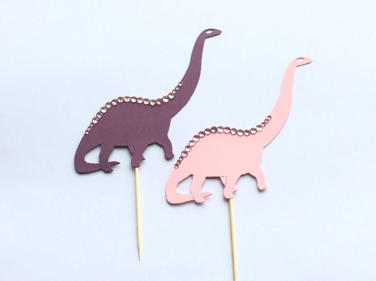 A personal favourite from my Etsy shop https://www.etsy.com/uk/listing/556103515/girls-dinosaur-cake-toppers-dinosaur