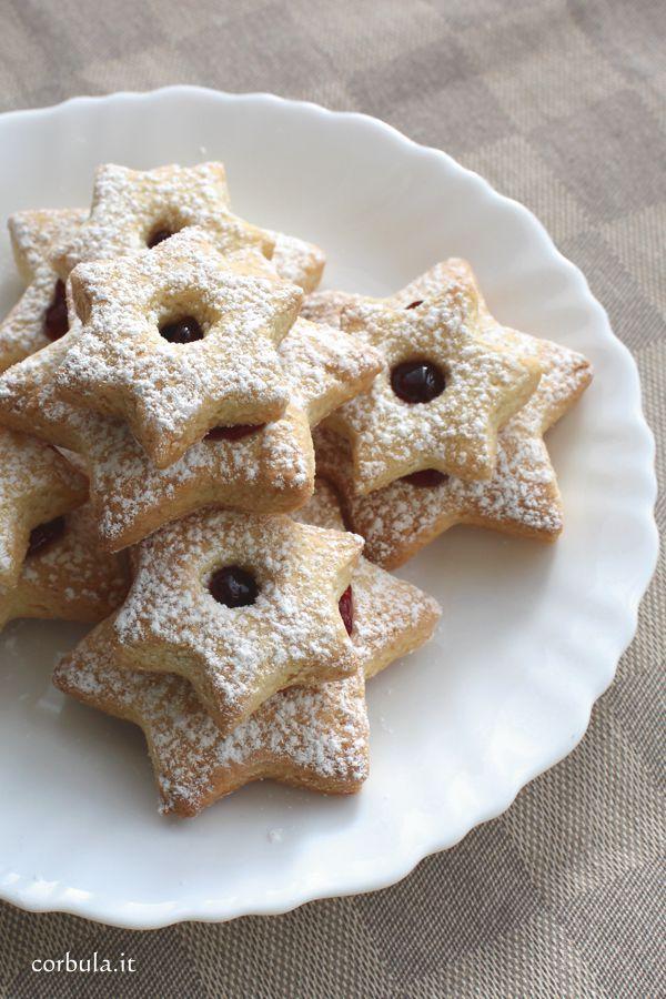 La ricetta delle Ciambelle sarde. Preparate con la pasta frolla e decorate  con la confettura
