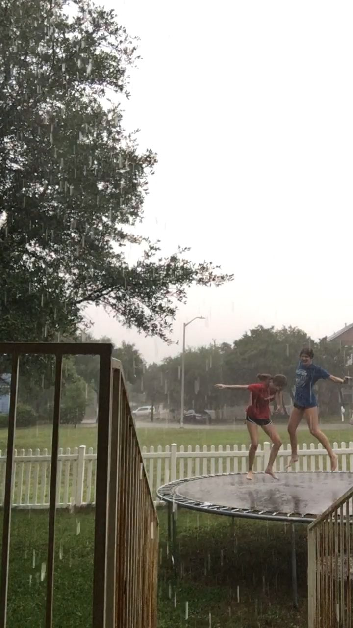 besties jumping in the rain – vivienne hagen