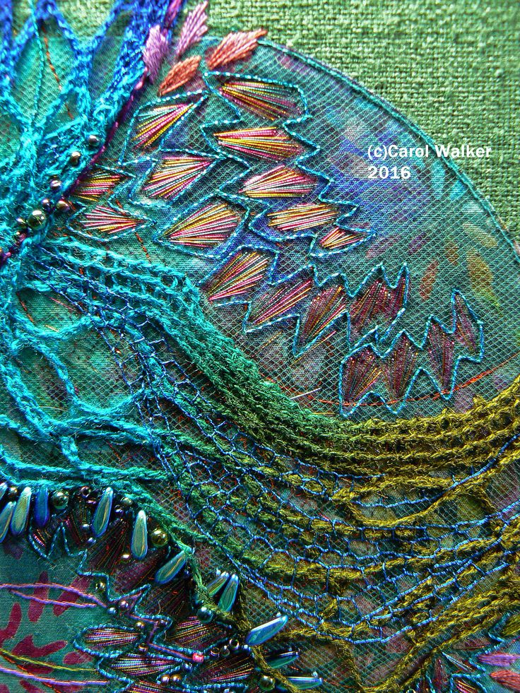 https://flic.kr/p/N2vCGs | Bry's Iggy detail - upper right - P1480263 | Close up detail photo of the last of the Iggy series of embroideries by me (Carol Walker) based o the skin of an iguana. Each Iggy is titled after a family member.  This one is for my son Bryon.  © 2016 Carol Walker. All rights reserved.  Bry's Iggy is displayed in a 12-inch round hoop. Base is a silk linen blend with a slubby texture. Materials include commercial cotton batik, acrylic knitted net, tulle, dichroic glass…