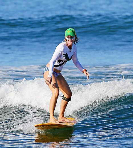 Helen Hunt caught a wave while filming Ride in Hawaii. 51 years old