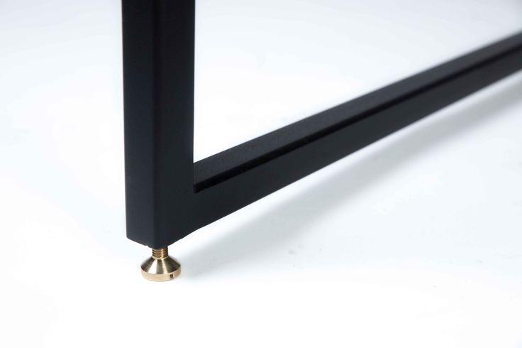 It's all about the details. Adjustable brass foot on the Albert dining table.