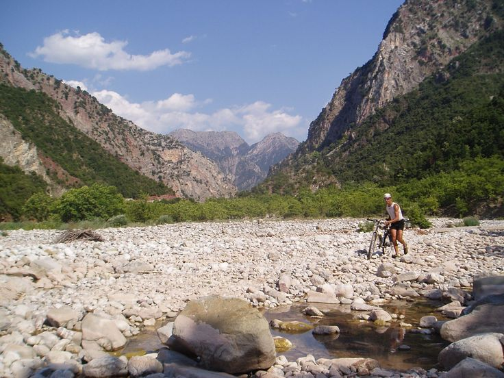KARPENISI  This area is in mainland Greece west of Delphi.  This is a river bed with a river in the foreground.  The map indicated a brdige but there was none, so we had to portage the river with our bikes and panniers.  Always an adventure with Giorgos.